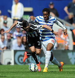 Newcastle United's Remy Cabella is challenged by Queens Park Rangers' Leroy Fer - Photo mandatory by-line: Dougie Allward/JMP - Mobile: 07966 386802 - 16/05/2015 - SPORT - football - London - Loftus Road - QPR v Newcastle United - Barclays Premier League