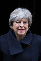 © Licensed to London News Pictures. 13/12/2017. London, UK. Prime Minister Theresa May leaves 10 Downing Street on her way to Prime Minister's Questions. Photo credit: Rob Pinney/LNP