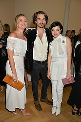 Left to right, MAGDALENA GABRIEL, EDWARD AKROUT and EVA LANSKA at a private view and auction of millinery organised by author, philanthropist and hat collector Eva Lanska in aid of Women for Women International held at Pace, Burlington Gardens, London on 10th June 2015.