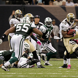 2009 October 04: New Orleans Saints running back Reggie Bush (25) runs back a punt during 24-10 win by the New Orleans Saints over the New York Jets at the Louisiana Superdome in New Orleans, Louisiana.