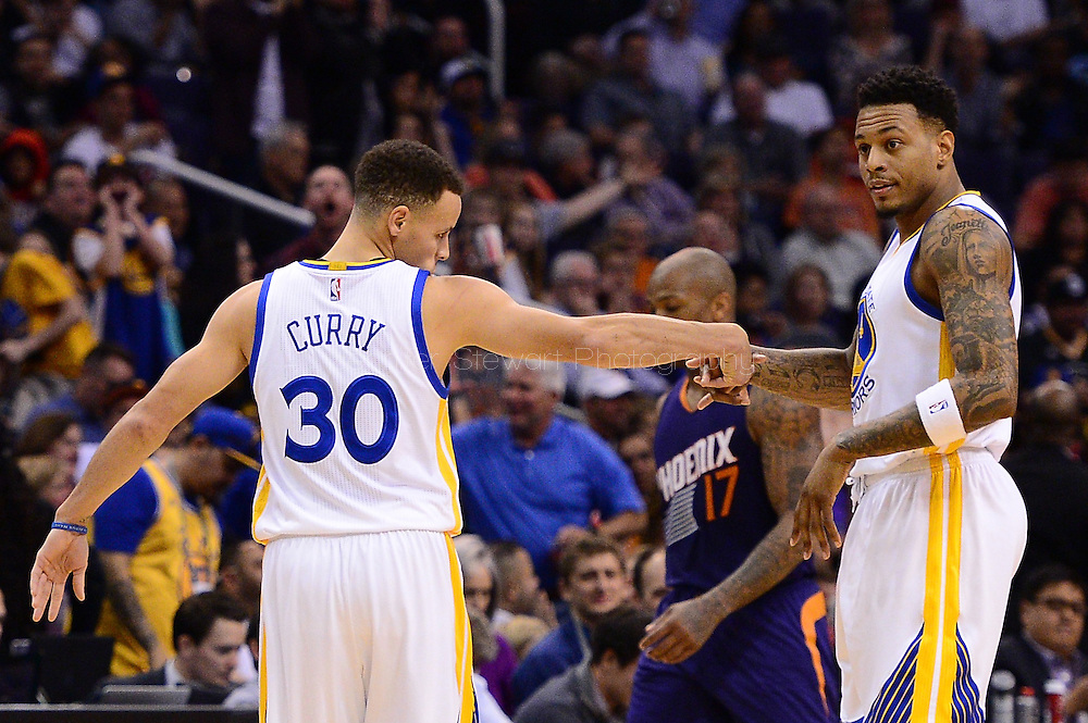 Feb 10, 2016; Phoenix, AZ, USA; Golden State Warriors guard Stephen Curry (30) is congratulated by forward Brandon Rush (4) in the game against the Golden State Warriors at Talking Stick Resort Arena. Mandatory Credit: Jennifer Stewart-USA TODAY Sports
