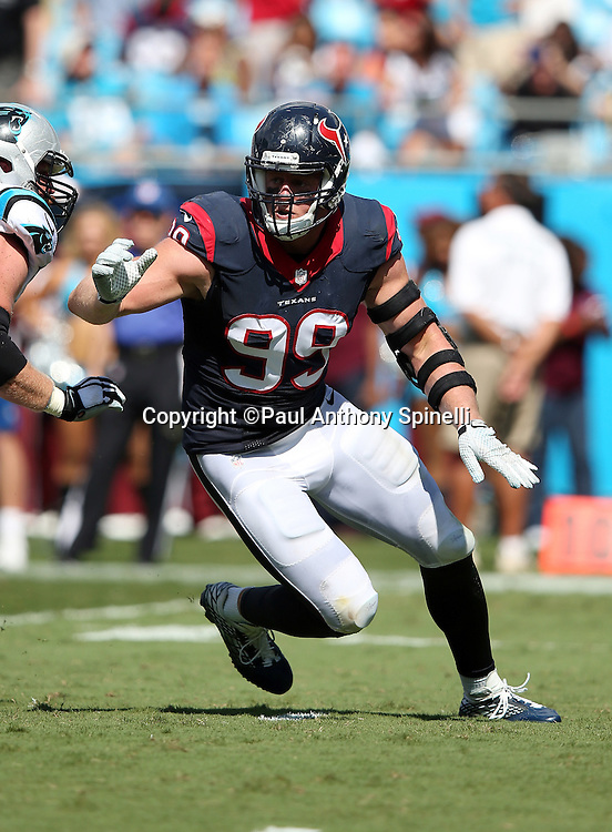 Houston Texans defensive end J.J. Watt (99) rushes the quarterback around a block attempt by Carolina Panthers tackle Mike Remmers (74) during the 2015 NFL week 2 regular season football game against the Carolina Panthers on Sunday, Sept. 20, 2015 in Charlotte, N.C. The Panthers won the game 24-17. (©Paul Anthony Spinelli)