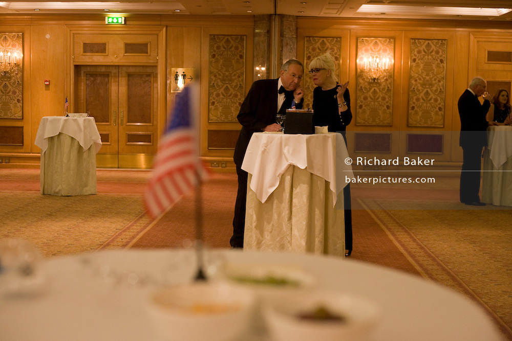 Elderly members of expatriate US citizens and 'Democrats Abroad' party supporters talk in an empty ballroom before others arrive to celebrate the inauguration of Barack Obama as the United States' 44th President, after his Nov 08 election victory as America's first African American Commander in Chief. The location is The Royal Lancaster Hotel in central London, England. Similar events were held by Democrats Abroad around the world but in England, Obama's election to the White House excited Britain's political and cultural landscape during a deep economic recession. .