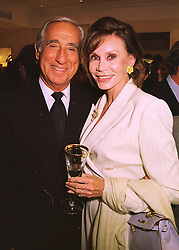 MR & MRS KEN LIEBERMAN at a party in London on 10th June 1998.<br /> MIF 1