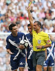 Tenerife's Bellvis and the referee Mr.Cesar Muniz Fernandez have words during La Liga match.September 2 2009.