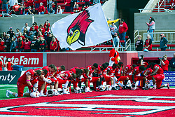 NORMAL, IL - October 05:  Several Redbirds kneel in prayer before the start of the college football game between the ISU (Illinois State University) Redbirds and the North Dakota State Bison on October 05 2019 at Hancock Stadium in Normal, IL. (Photo by Alan Look)