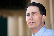 Republican presidential candidate Wisconsin Gov. Scott Walker speaks with the media at the Highland Park Soda Fountain in Dallas, Texas on September 2, 2015. (Cooper Neill for the Texas Tribune)