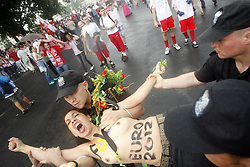08-06-2012 VOETBAL: EURO 2012 POLEN - GRIEKENLAND: WARSCHAU<br /> The feminist movement Femen protested, in front of the UEFA Euro 2012 Opening Match between Poland and Greece. Police arrest those at the National Stadium Warsaw<br /> ***NETHERLANDS ONLY***<br /> ©2012-FotoHoogendoorn.nl/NPH-Martin