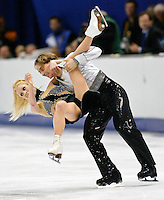 Canadian figure skater Shae-Lynn Bourne (L) goes down on the ice while in the arms of partner Victor Kraatz at the end of their free dance performance at the Salt Lake 2002 Olympic Winter Games, February 18, 2002. The Canadians finished in fourth place.  REUTERS/Rick Wilking