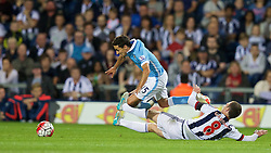 WEST BROMWICH, ENGLAND - Monday, August 10, 2015: Manchester City's Jesus Navas is tackled by West Bromwich Albion's Craig Gardner during the Premier League match at the Hawthorns. (Pic by David Rawcliffe/Propaganda)