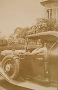woman posing in a car