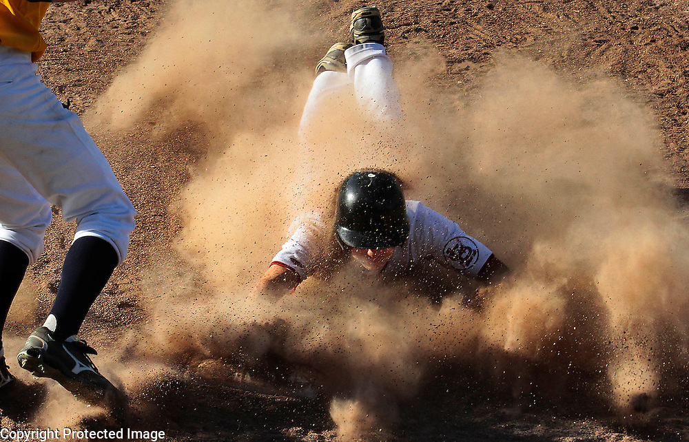 San Lorenzo Valley's Patrick Primeau gets a face full of dust as he steals third base in the seventh inning of SLV's 9-inning victory over Soquel High on May 8.<br />