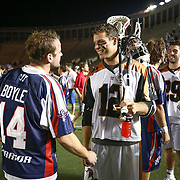 Justin Turri #12 of the Rochester Rattlers speaks with Ryan Boyle #14 of the Boston Cannons following the game at Harvard Stadium on August 9, 2014 in Boston, Massachusetts. (Photo by Elan Kawesch)