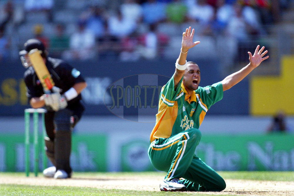 13 February 2004, International one day cricket, Eden Park, Auckland, New Zealand. Match 1 in series of 6, New Zealand vs South Africa..South African spin bowler, Robin Peterson appeals to the umpire, for the wicket of Chris Cairns, lbw..Pic: Andrew Cornaga/Photosport