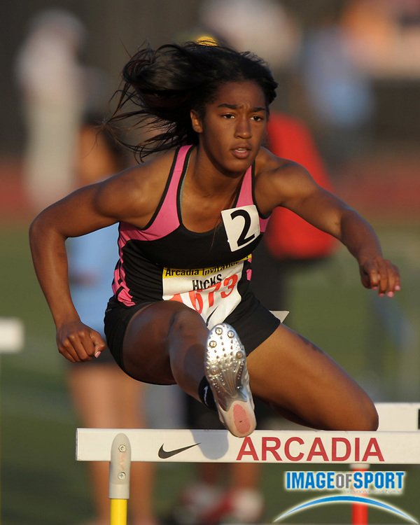 Apr 6, 2012; Arcadia, CA, USA; Traci Hicks runs the second leg on the Long Beach Poly girls 4 x 100m shuttle hurdle relay that won in 58.11 in the Arcadia Invitational at Arcadia High.