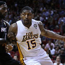 March 10, 2011; Miami, FL, USA; Los Angeles Lakers small forward Ron Artest (15) drives by Miami Heat small forward LeBron James (6) during the first quarter at the American Airlines Arena.  Mandatory Credit: Derick E. Hingle