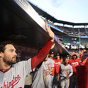 NEW YORK, NEW YORK - May 19: Daniel Murphy #20, (left), of the Washington Nationals congratulates team mates after the Nationals scored seven runs in the third inning during the Washington Nationals Vs New York Mets regular season MLB game at Citi Field on May 19 2016 in New York City. (Photo by Tim Clayton/Corbis via Getty Images)