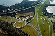 Nederland, Zuid-Holland, Harinvliet, 01-04-2016; Hellegatsplein, kunstmatig eiland en  onderdeel van de Volkerakwerken. Hellegatsplein ligt in het Hellegat, de driesprong van Haringvliet, Hollandsch Diep en Volkerak. Verkeersknooppunt tussen de A29 en de N59.<br /> Artificial island and traffic junction in the Haringvliet estuary.<br /> <br /> luchtfoto (toeslag op standard tarieven);<br /> aerial photo (additional fee required);<br /> copyright foto/photo Siebe Swart