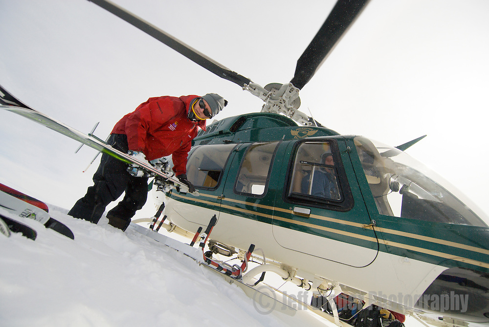 Jon Shick unloads the heli for High Mountain Heli Skiing in Jackson Hole, Wyoming.