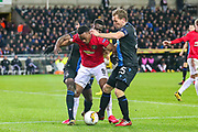 Manchester United forward Anthony Martial (9) tussles with Club Brugge defender Odilon Kossounou (5) and Club Brugge midfielder Ruud Vormer (25) during the Europa League match between Club Brugge and Manchester United at Jan Breydel Stadion, Brugge, Belguim on 20 February 2020.