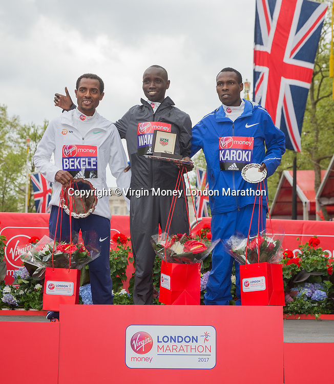 Daniel Wanjiru KEN, with Kenenisa Bekele ETH and Bedan Karoki Muchiri KEN stand on the podium after the Elite Men&rsquo;s Race. The Virgin Money London Marathon, 23rd April 2017.<br /> <br /> Photo: Ben Queenborough for Virgin Money London Marathon<br /> <br /> For further information: media@londonmarathonevents.co.uk