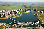 Nederland, Utrecht, Houten, 11-02-2008; VINEX lokatie, nieuwbouwwijk met huizen in oud-hollandse stijl, waterhuizen, houten gevels, waterwoning, water-woning, waterwonen, water wonen; houses in neo-style on bank of artificial lake / pond in new housing district - imitating construction methods of the past; houses, construction, residential, suburb Utrecht - VINEX location; water, water management, climate change, global warming, environment, living, water, housing, house, innovation, climate change, carbon dioxide, greenhouse gases, warming of the planet.luchtfoto (toeslag); aerial photo (additional fee required); .foto Siebe Swart / photo Siebe Swart