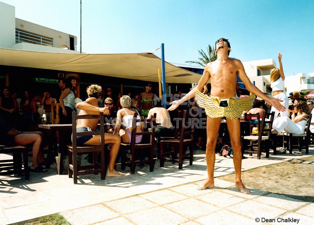 Man wearing angel wings looking up at the sky, Bora Bora Bar, Playa D'en Bossa, Ibiza 1999