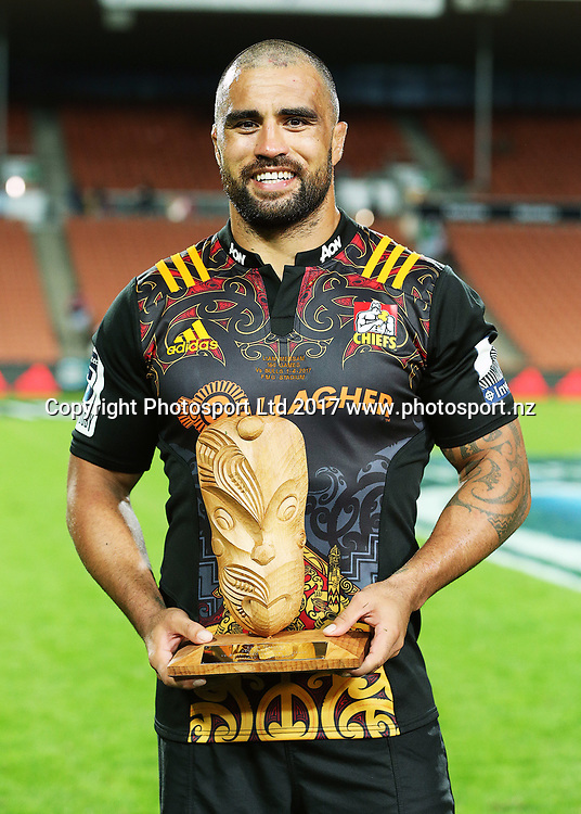 Chiefs' flanker Liam Messam with an award to acknowledge him playing 150 Super Rugby games for the Chiefs franchise. Super Rugby rugby match - Chiefs v Bulls played at FMG Stadium Waikato, Hamilton, New Zealand on Saturday 1 April 2017.  Copyright photo: Bruce Lim / www.photosport.nz