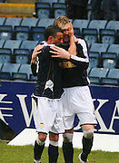Dundee's Kevin McDonald celebrates with team-mate Derek Lyle after scoring during the IRN BRU Scottish League First Division match against Clyde at Dens Park