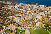 An aerial view of Madison, Wisconsin, Unity Point-Meriter Hospital (below), the University of Wisconsin-Madison's Camp Randall Stadium, surrounded by Lakes Mendota (above) and Picnic Point.