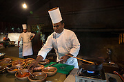Sous Chef Sujith Arlyaratne makes Cinnamon honey crab at the Nugagama Restaurant at the Cinnamon Grand Hotel in central Colombo. The restaurant is renowned for its traditional 'village' Sri Lankan food with every dish using cinnamon in some degree.
