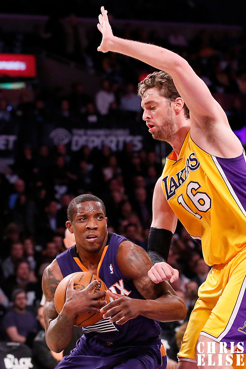 10 December 2013: Phoenix Suns point guard Eric Bledsoe (2) drives past Los Angeles Lakers center Pau Gasol (16) during the Phoenix Suns 114-108 victory over the Los Angeles Lakers at the Staples Center, Los Angeles, California, USA.