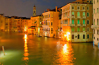 Fantasy photo in orange of the Grand Canal at night in Venice, Italy.