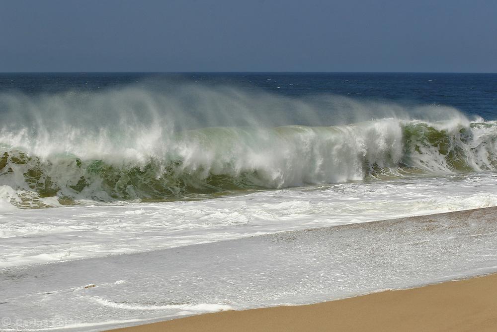A wave splash in a beach of Cabo San Lucas, Baja california, Mexico