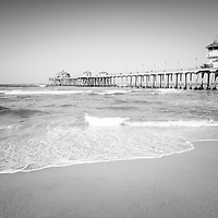 Huntington Beach Pier black and white photo. Huntington Beach Pier is a registered historic place along the Pacific Ocean in Orange County California.  Huntington Beach is also known as Surf City USA. Image Copyright © 2012 Paul Velgos with All Rights Reserved.