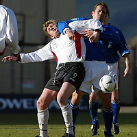 Clyde v St Johnstone...06.03.04<br />Andy Smith and Paul Bernard tangle<br /> <br />Picture by Graeme Hart.<br />Copyright Perthshire Picture Agency<br />Tel: 01738 623350  Mobile: 07990 594431