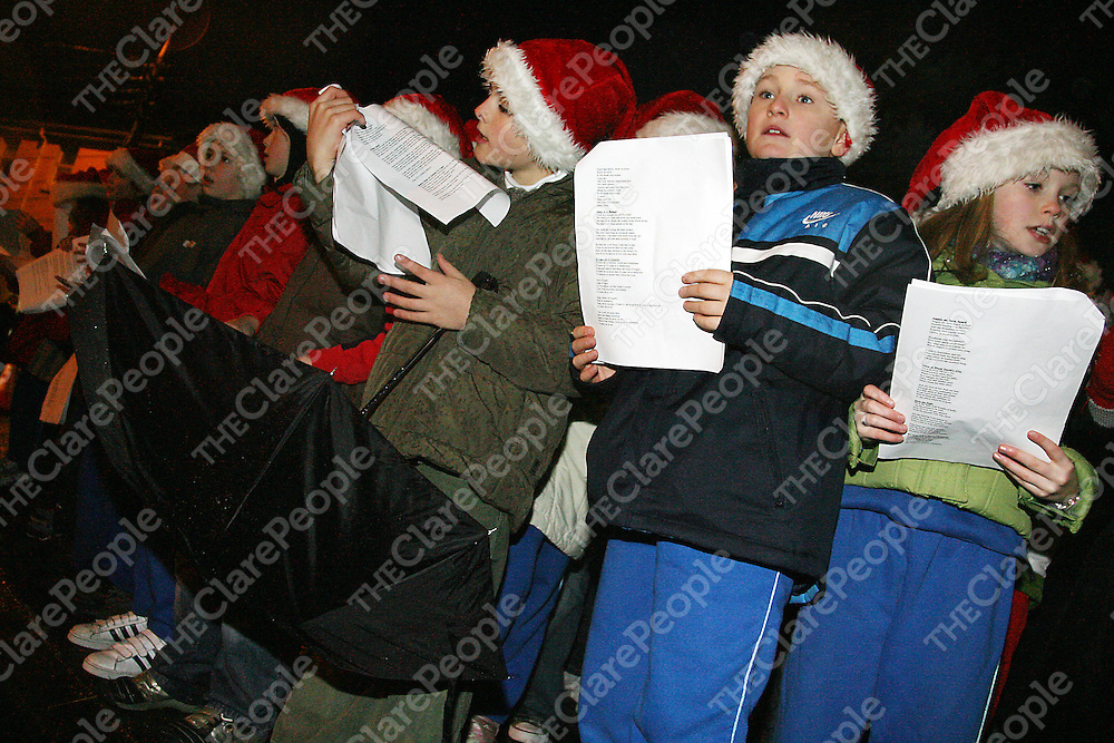 There wasn't enough hands to hold everything at the annual switching on of the Christmas lights in Ennis on Thursday evening.<br />