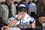 Israel, Old City of Jerusalem, Bar Mitzvah ceremony A young boy of 13 laying Tefillin at the Wailing Wall