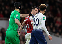 Football - 2018 / 2019 EFL Carabao Cup (League Cup) - Quarter-Final: Arsenal vs. Tottenham Hotspur<br /> <br /> Tempers flare as GranitXhaka (Arsenal FC) confronts Dele Alli (Tottenham FC) and is pulled away by Petr Cech (Arsenal FC) at The Emirates.<br /> <br /> COLORSPORT/DANIEL BEARHAM