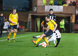 Falkirk's Thomas Grant  tackled by Dunfermline's Josh Falkingham..Dunfermline 0 v 1 Falkirk, 26/12/2012..©Michael Schofield.