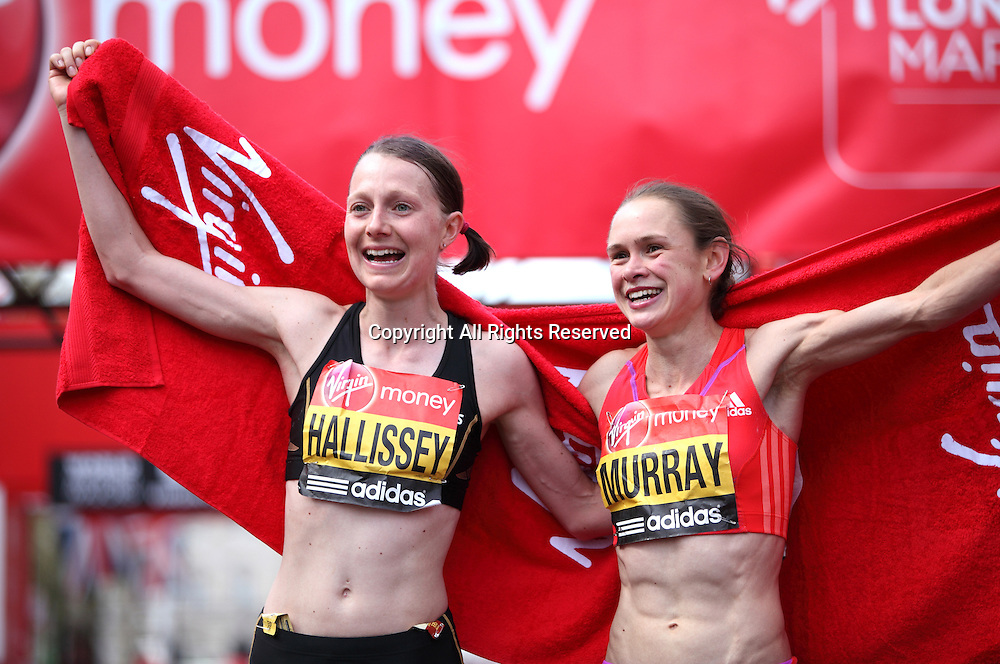 22.04.2012 London, England. The Mall, in front of Buckingham Palace. Claire Hallissey (Great Britain & NI) poses with Freya Murray after completing the Virgin London Marathon.