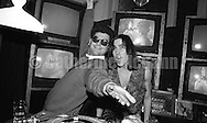 Oct 17 1990:  Village Voice columnist Michael Musto  (L) and DJ in front of a bank of televisions at the Limelight nightclub in New York City, New York.