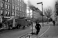 Firemen tackle blaze in Dublin Road, Belfast, N Ireland, following Provisional IRA explosions 6th December 1971. 197112060541a<br />
