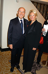 Bookmaker FRED DONE and his wife MO at The Sir Peter O'Sullevan Charitable Trust Lunch at The Savoy, London on 23rd November 2005.<br />