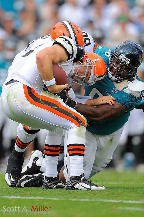 Cleveland Browns quarterback Colt McCoy (12) spins away from Jacksonville Jaguars defensive tackle Terrance Knighton (96) during the Browns 24-20 loss to the Jacksonville Jaguars at EverBank Field on Nov. 21, 2010 in Jacksonville, Florida. ..©2010 Scott A. Miller