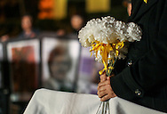 A supporter holds flowers during a candlelight vigil in remembrance and support of 'Comfort Women', Japanese military sexual slavery victims during World War II, at Glendale Peace Monument on January 5, 2016 in Glendale, California. AFP PHOTO / Ringo Chiu