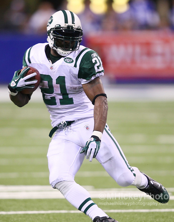Jan. 08, 2011; Indianapolis, IN, USA; New York Jets running back LaDainian Tomlinson (21) looks to turn the corner against the Indianapolis Colts during the 2011 AFC wild card playoff at Lucas Oil Stadium. Mandatory credit: Michael Hickey-US PRESSWIRE