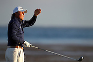 Phil MICKLESON (US) shades his eyes from the sun after hitting his tee shot at 18th par 5 during third round US Open 2010,Pebble Beach Golf Links,Pebble Beach, California, USA.