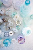 A spiral of vintage bottles.