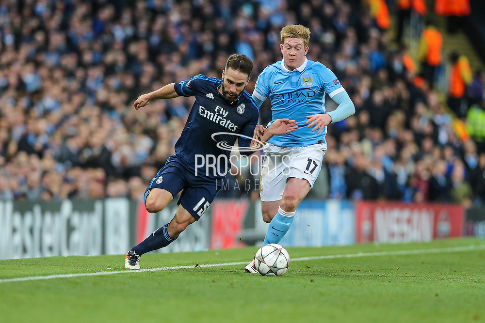 Real Madrid's Daniel Carvajal fights off Manchester City's Kevin De Bruyne during the Champions League match between Manchester City and Real Madrid at the Etihad Stadium, Manchester, England on 26 April 2016. Photo by Shane Healey.